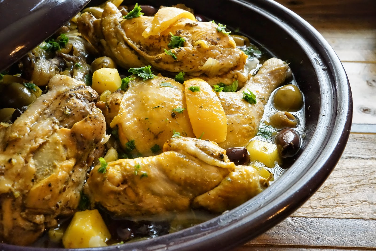 Moroccan preserved lemon chicken tagine chef rachida increase the heat under the tagine and cook until the sauce is reduced to a thick consistency about 10 15 minutes longer add parsley cilantro and lemon forumfinder Images