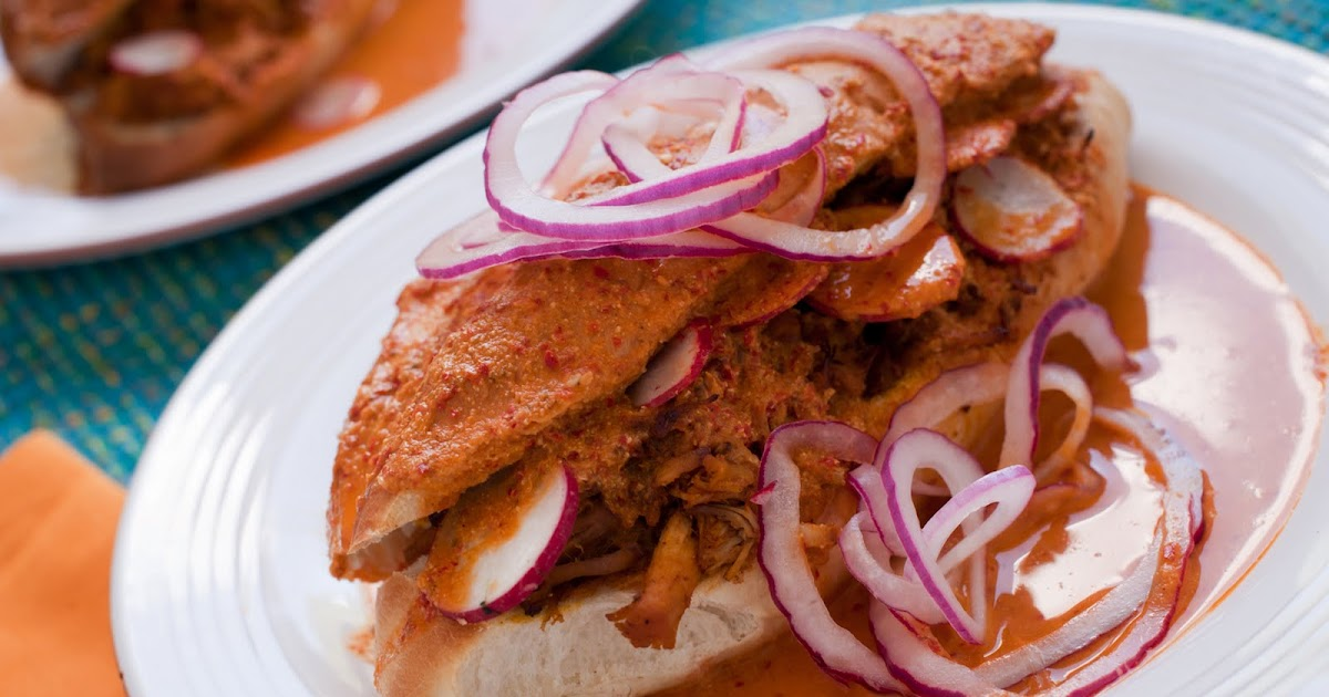 Torta-Ahogada-with-Pickled-Red-Onions-and-Refried-Beans.jpg