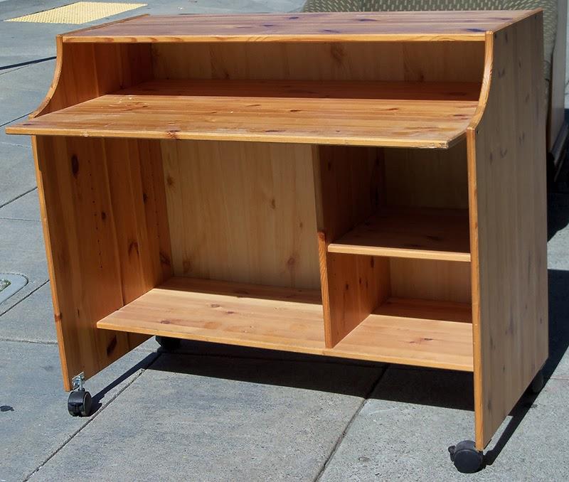 Uhuru Furniture Collectibles Sold Knotty Pine Desk On Wheels