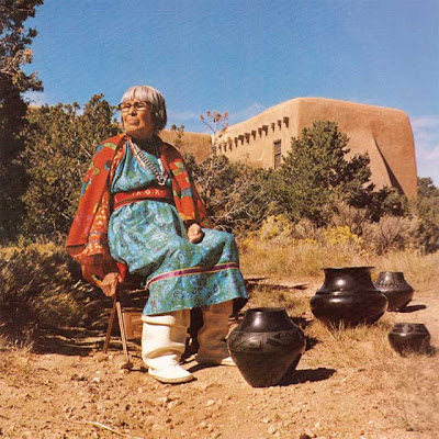 Maria Martinez posing with her pottery at San Ildefonso 1976