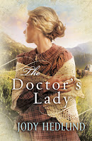 cover of The Doctor's Lady by Jody Hedlund shows a pioneer woman wrapped in a shawl turned away