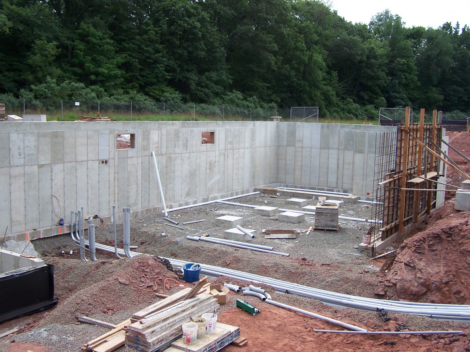 [basement Foundation Walls With Area Left Open For Access To Basement;  Electrical Conduit And Underslab Plumbing In Progress]