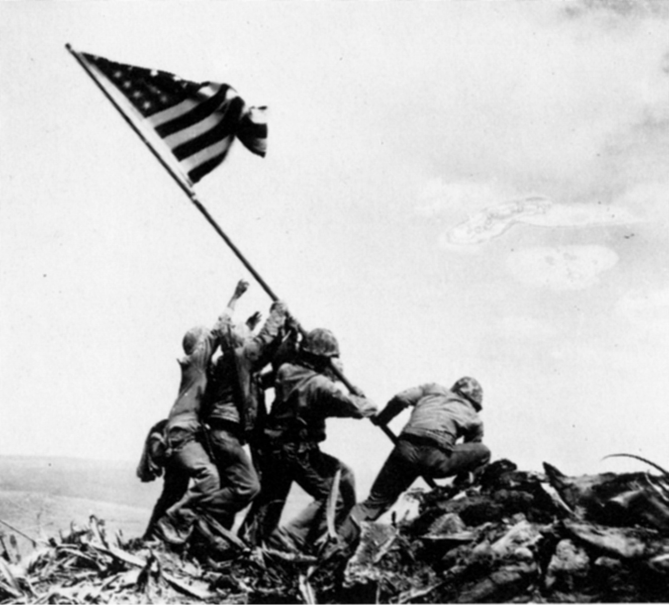 soldiers raising the american flag