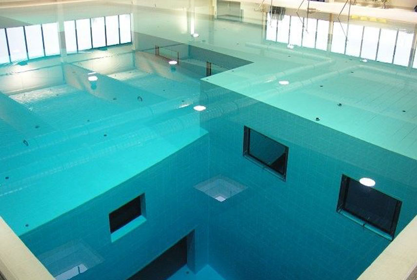Surreal swimming pools around the world for Deepest indoor swimming pool in the world