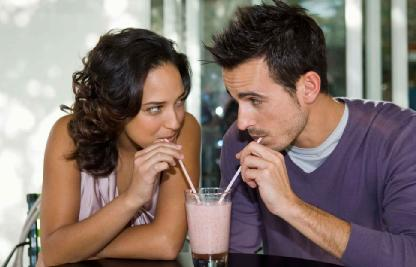 Is Your Date Compatible? Find Out In Ten Topics - man and woman drink juice from one cup glass