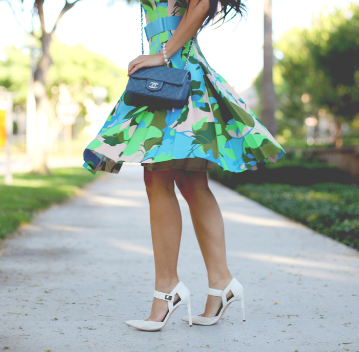 Stephanie Liu of Honey & Silk is wearing a Jonathan Saunders x Motilo dress, Aldo x Preen heels, Chanel bag, CC Skye pave spike bracelet, and Tacori city light studs.
