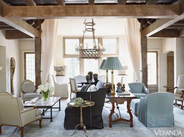 large open floor plan veranda living room in blue and tan