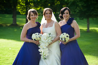 bride and her bridesmaids holding bouquets with soft romantic hairstyles