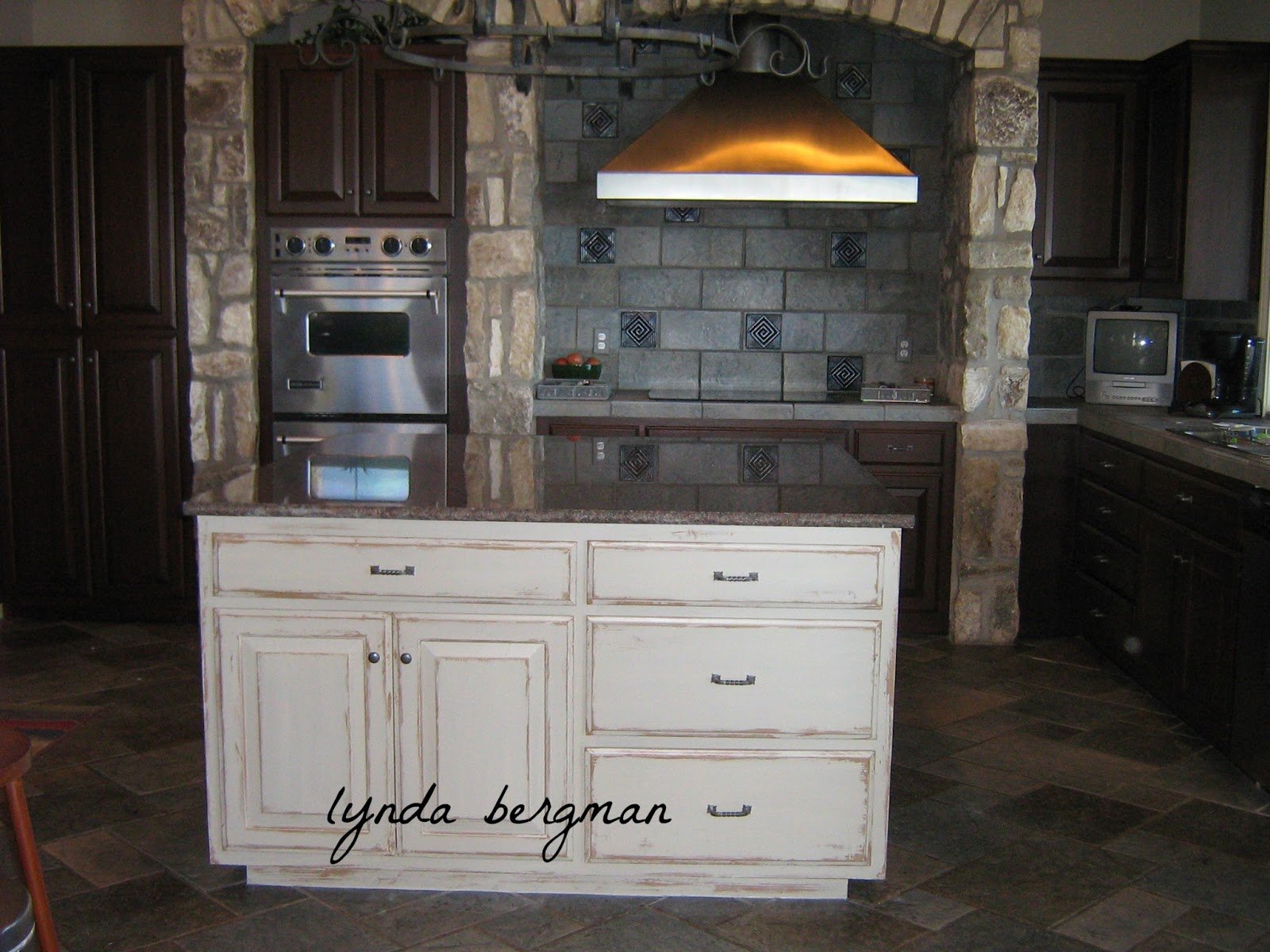 light colored island looked so nice with her new dark cabinet finish