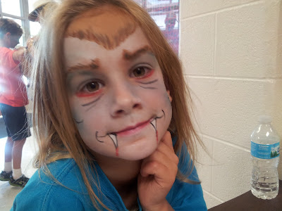Vampire face paint on a cute little girl