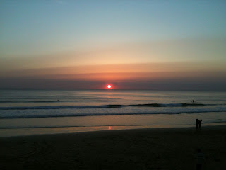 Sun setting over watergate bay Newquay Cornwall