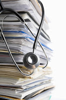 Stack of patient medical records