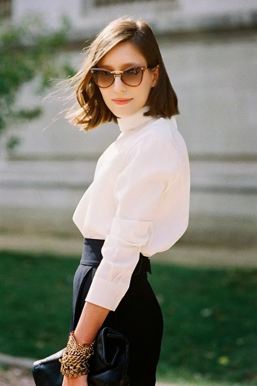 Parisian Chic is wearing a cateye sunglasses, white blouse and high waisted pants