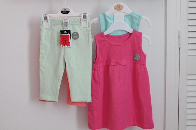 Mint green & pink leggings on one hanger, pink and green dress on another hanger
