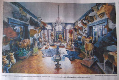 View of a large ornate sunroom with dozens of dead animals standing on the floor and mounted on the walls