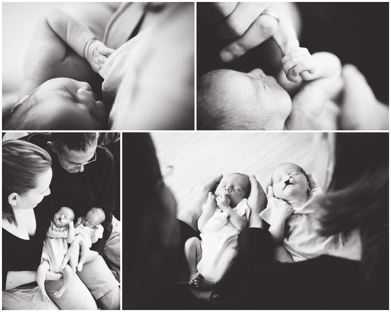 newborn twins in parents' hands