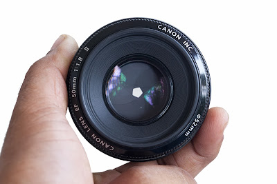 how to lock aperture of a lens at a certain setting