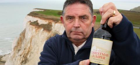Keith Lane with Beachy Head Christmas Jumper dark ale bottle