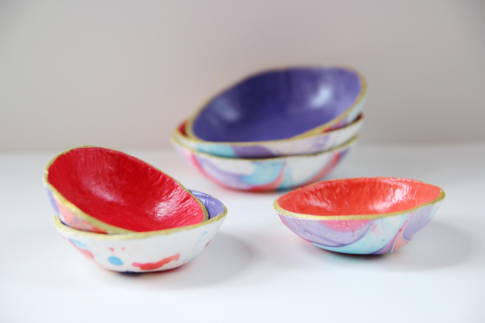 Use nail varnish and air dry clay to make these marbled bowls.