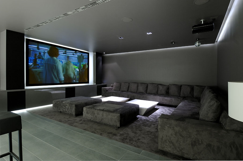 Home theater in Ultra Modern Concrete House by A-cero Architects