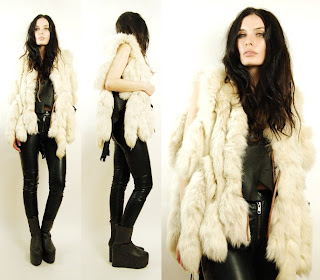 Vintage 1960's white leather and fox fur vest with open front.