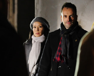 Jonny Lee Miller as Sherlock Holmes CBS Elementary Episode 15 A Giant Gun, Filled with Drugs