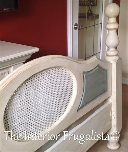 Close up picture of the cane on the headboard painted white