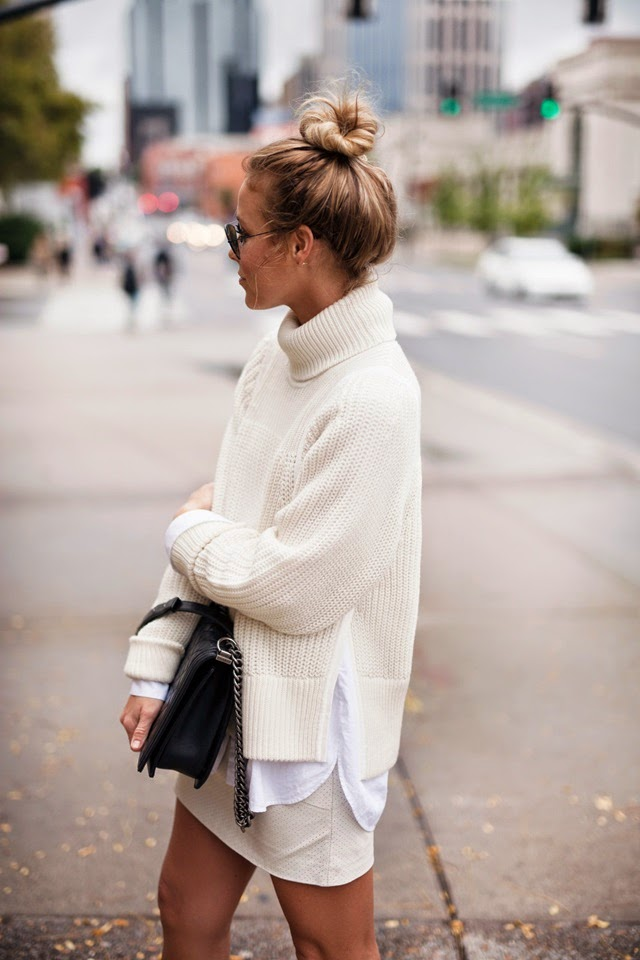messy bun and white chunky knit sweater. happily grey