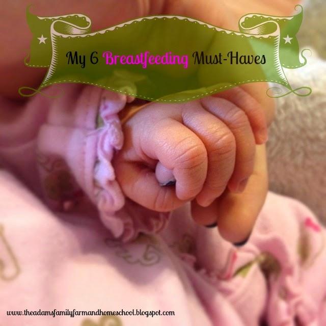 newborn hand holding finger
