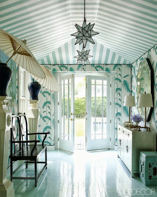 Chinoiserie inspired foyer with Chinese furniture, light blue wallpaper, a striped ceiling, parasols and high gloss floors in Oscar PR Girl's home