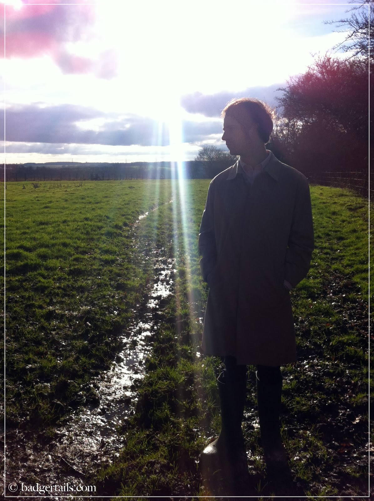 man standing in country field
