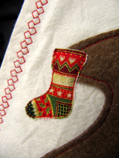 Christmas stocking appliqued to felt Gingerbread man