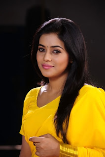 Poorna New Pictures in Yellow saree 008.jpg