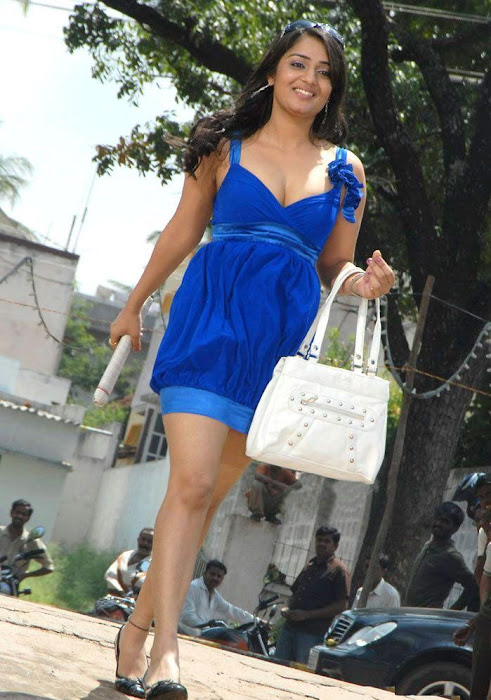 Nikitha in Blue Short Skirt Dress showing her thighs carrying a Handbag images