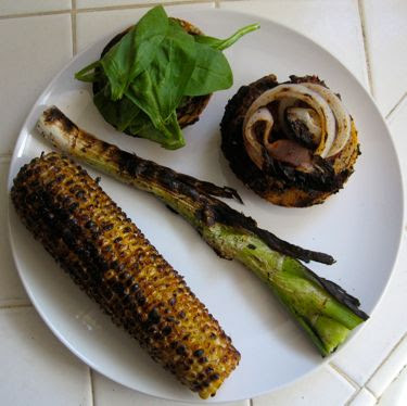 grilled corn, scallion, red onion, lamb burger, and spinach on sourdough bun with lemon-cayenne butter