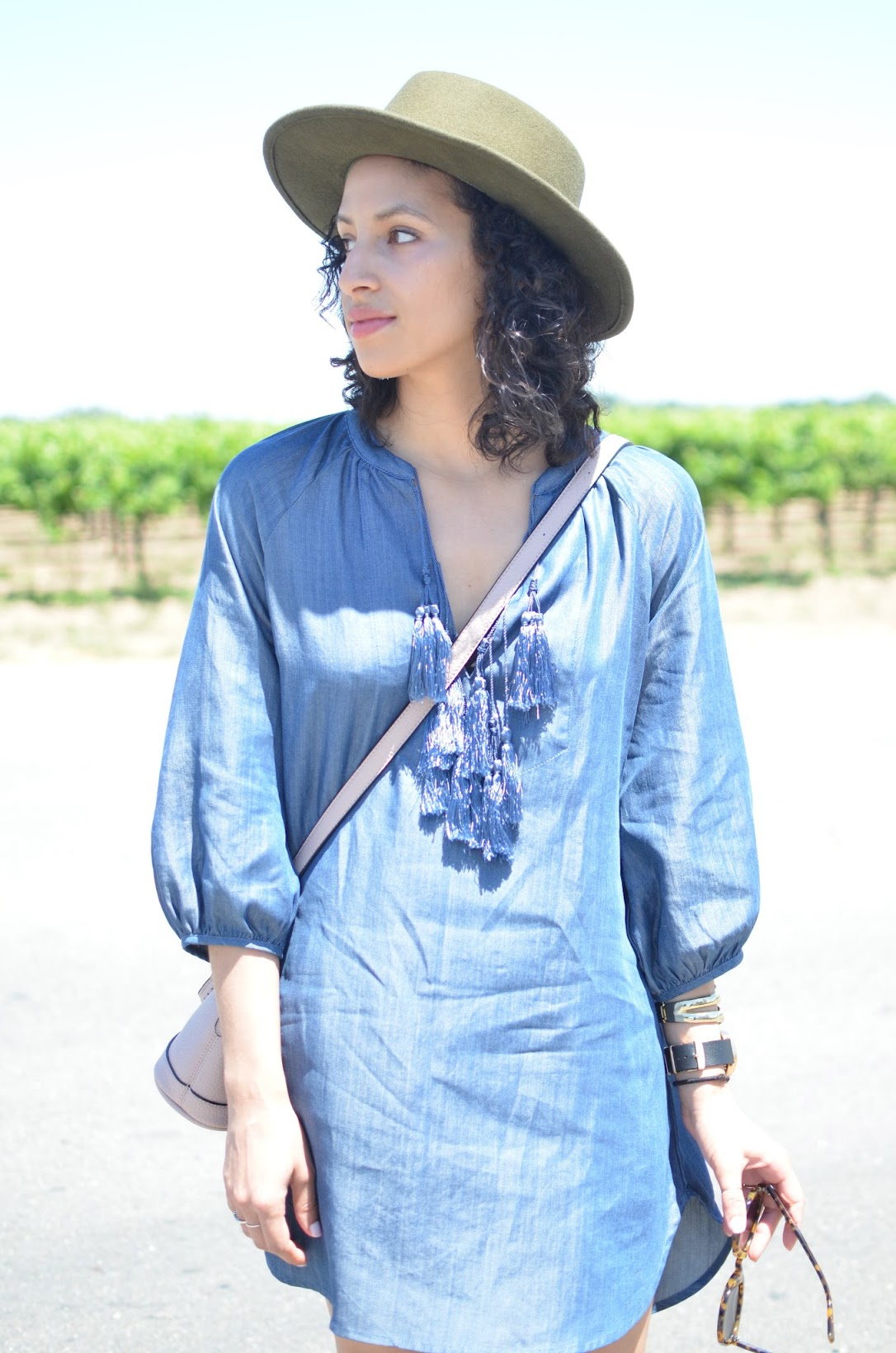 TopShelf Style, tunic, tassel tunic, SF style, Goorin Bros fedora, slide sandals, Urban Expressions, curly hair, Karen Walker Super Sunglasses, Lodi wine
