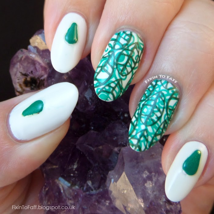 Green nail art manicure in honor of Depression Awareness #fightforlightandlive, featuring MoYou London stamping plates and green studs.