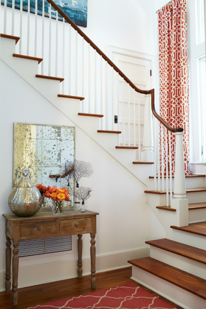 Coral print fabric in this coastal stairway