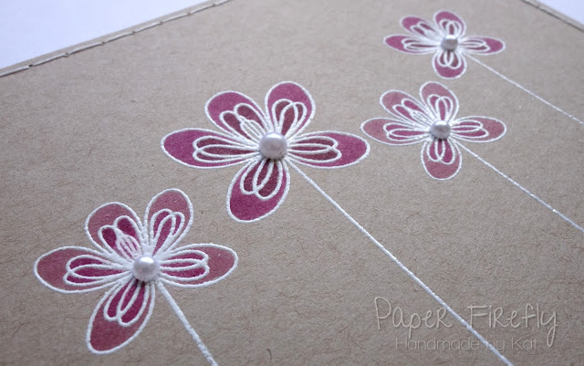 CAS card with white embossed and coloured flowers (Clearly Besotted stamp)