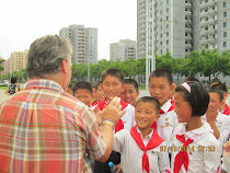 "Attractive youth (children of party members) who ""just happened"" to wander to our path in Pyongyang"