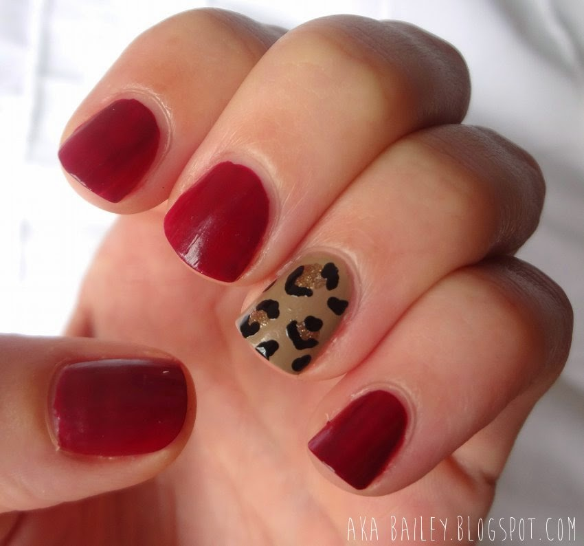 Burgundy nails with leopard print accent