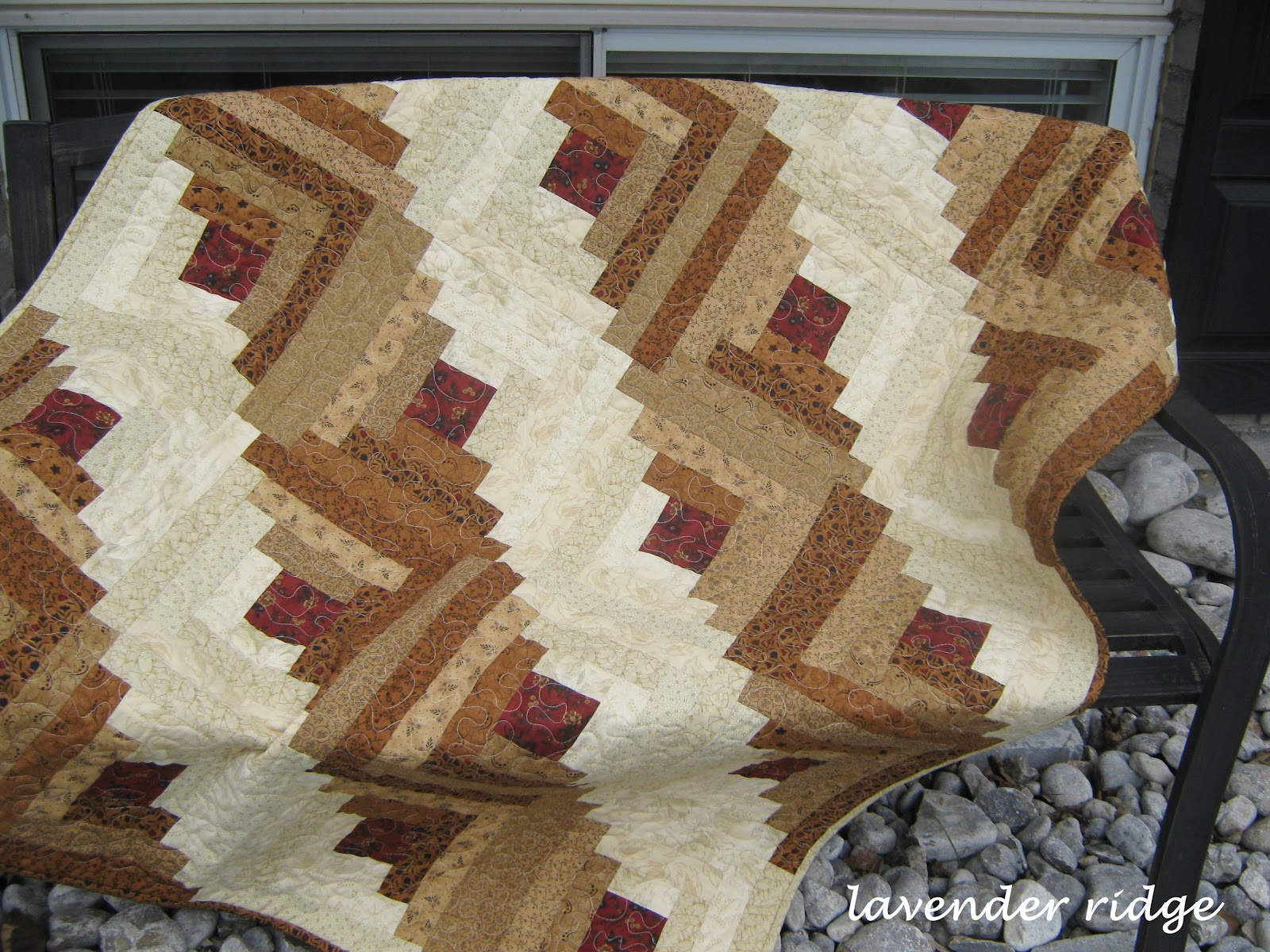White weathered hutch a log cabin quilt