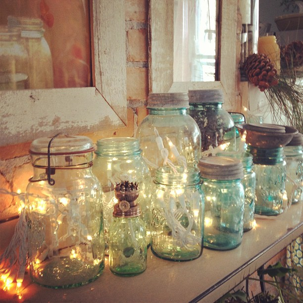 over the holidays i wound white christmas lights around my jars and liked it so much it will be permanent - Mason Jar Christmas Lights