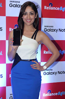 Yami Gautam Smiling Stunner in Half Shoulder White Top Blue Skirt at Launch of Samsung Galaxy Note 5