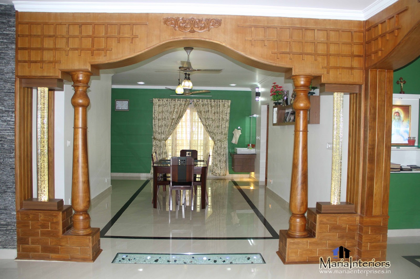 Kerala interior design decorations and wood works for House inside arch design