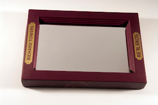 "The mirror-book ""Reflexions"" has a real mirror on his cover and the frame-box can be used has a passe-partout"