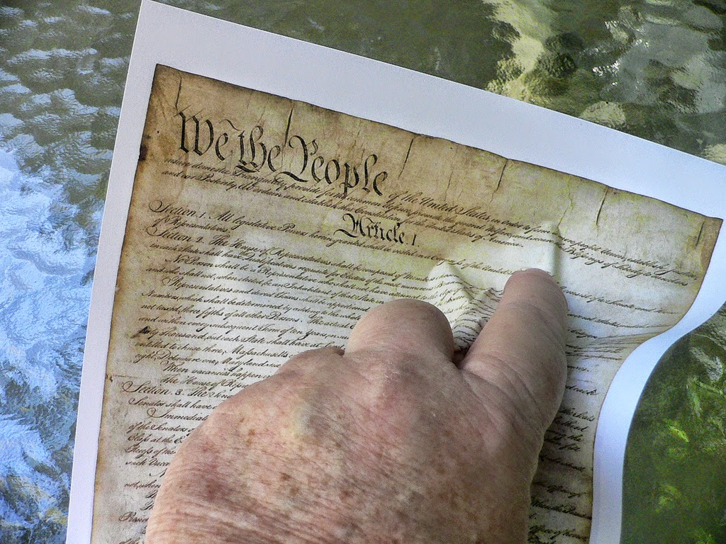 Hand crunching the declaration of independence, Independence Day (C) By Bev Sykes