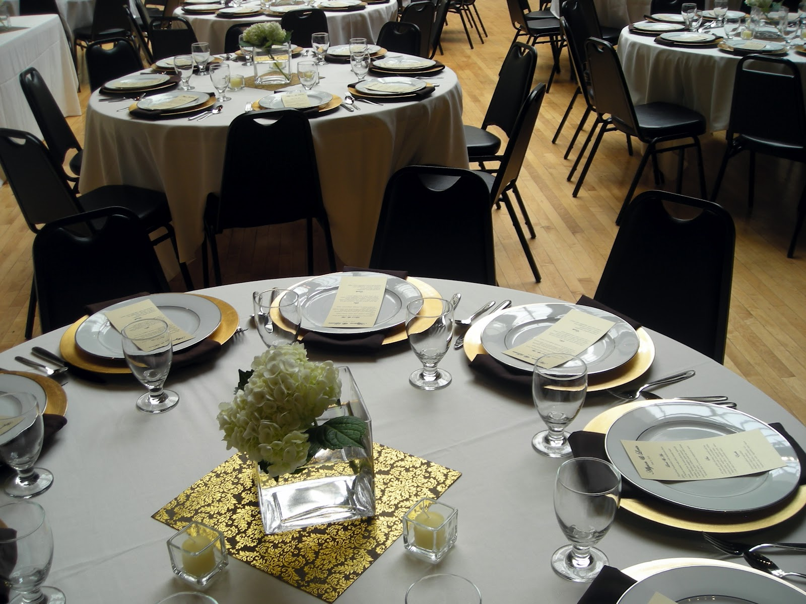 Planning tip 15 diy wedding centerpieces elite events rental shown here in a 6 cube vase rents for 4 and a 9 silver urn 4 rental use scrapbook paper to give the centerpiece a bigger foot print reviewsmspy