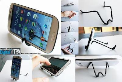 Base para móviles de alambre y cinta aislante