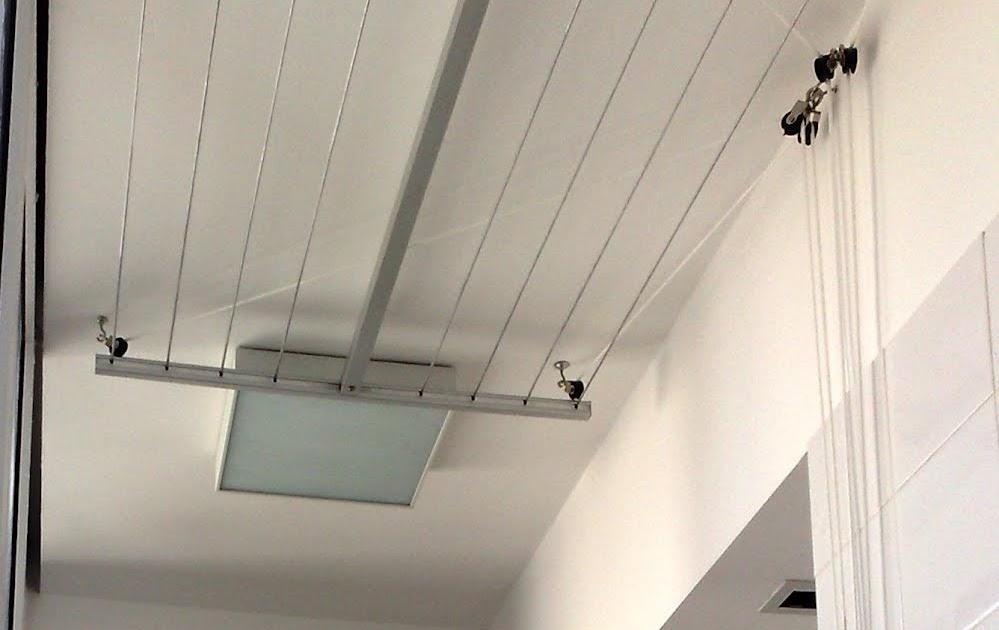 Tendederos colgantes de techo tendederos baco instalaci n en - Tendedero ropa pared ...